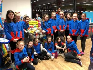 Around 18 Guides stand at their bag pack
