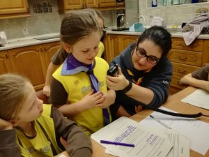 Brownies learning to use a radio communicator