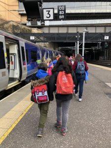Guides on a train platform