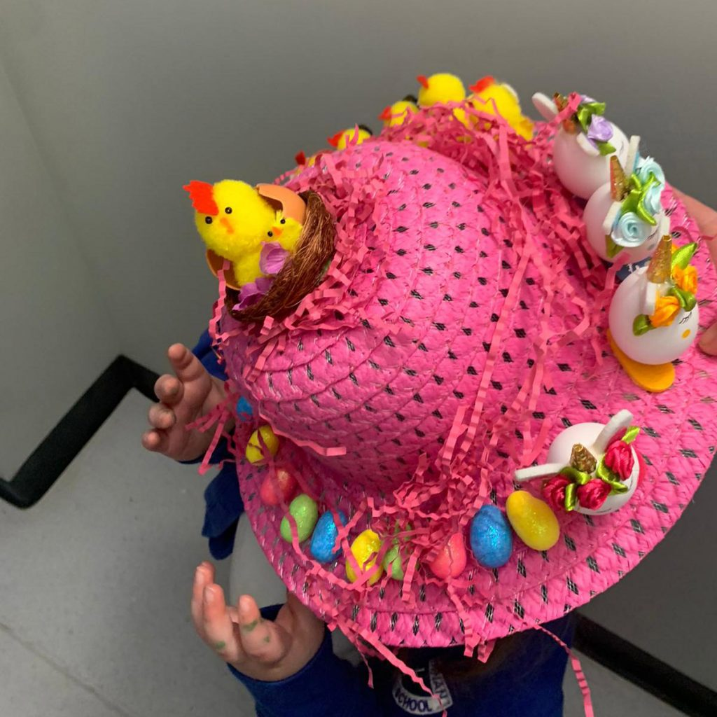 Pink bonnet decorated with eggs and chicks