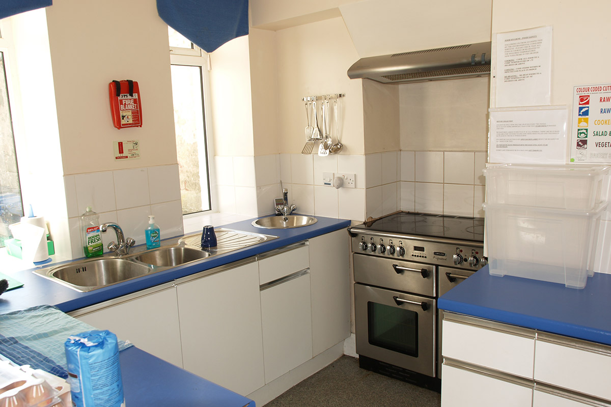 Kitchen with blue countertops and stove