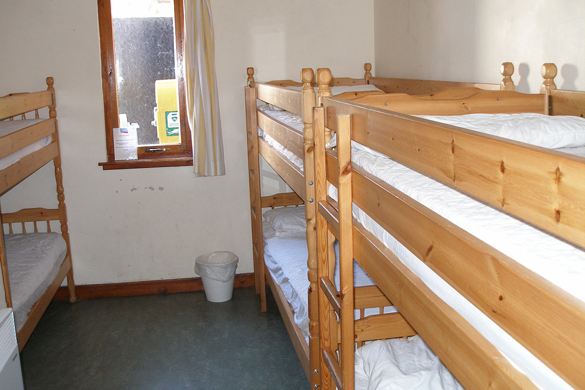 Dorm room of 6 bunk beds