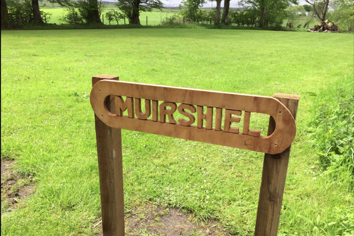 """Wooden sign with text """"MUIRSHIEL"""" carved out"""