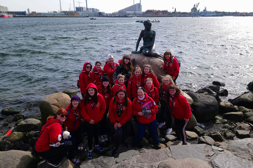 A group of Rangers in front of Mermaid statue