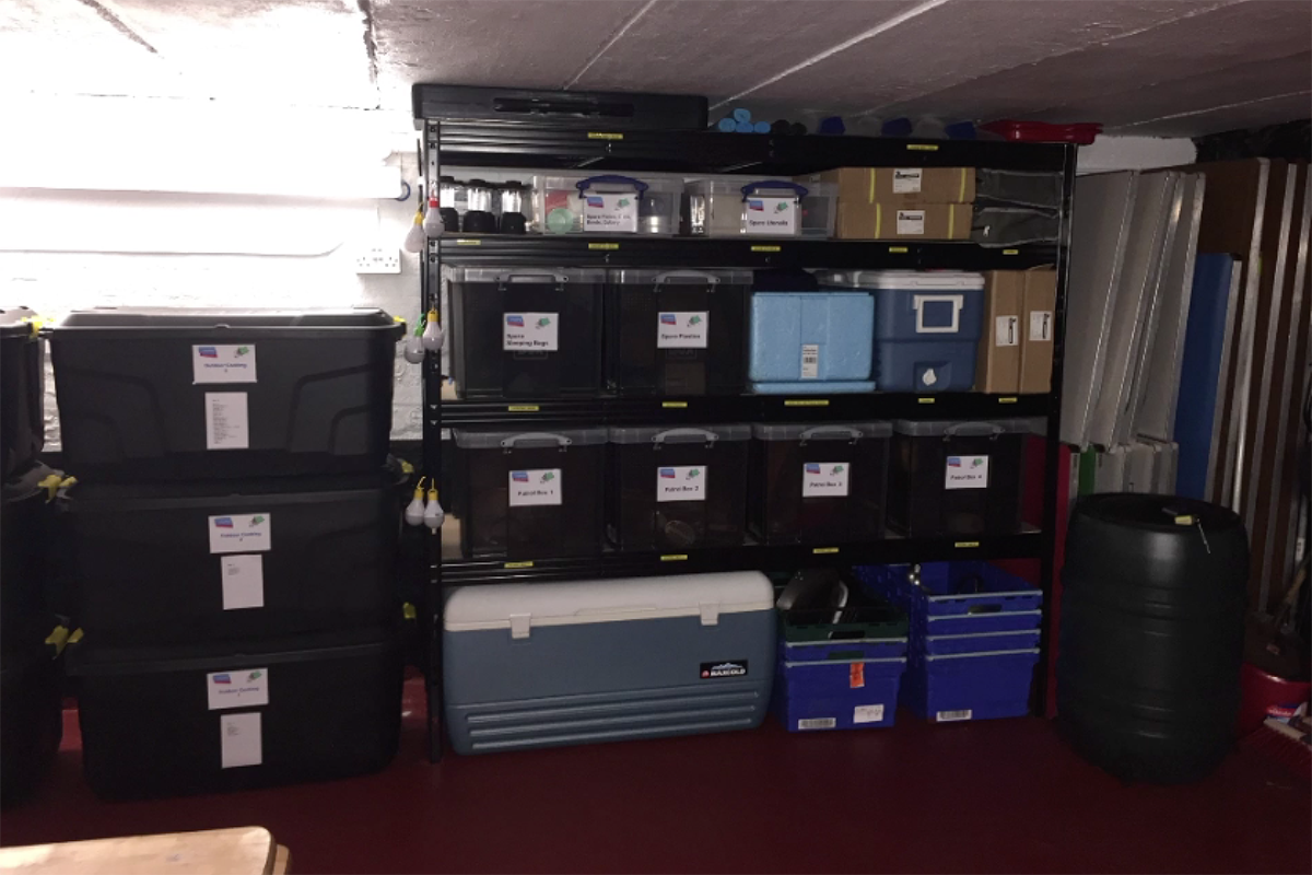 Shelves of boxes of camping equipment