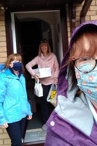 Selfie two women delivering gifts to doorstep