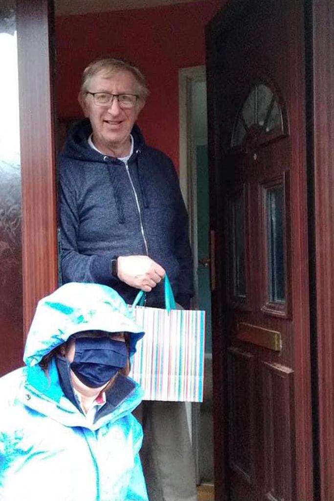 Women delivering gifts to doorstep