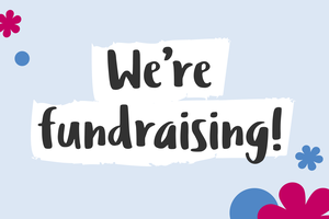 """Text: """"We're fundraising"""" in a handwritten font. In the background there are flowers and circle graphics."""